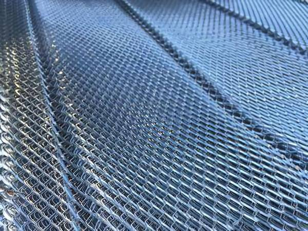 metal lath. the picture of diamond metal lath with v grooves, several sheets are overlapped together.