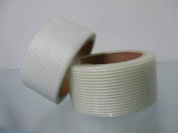 Two rolls of fiberglass tape with one lying and one inclined.