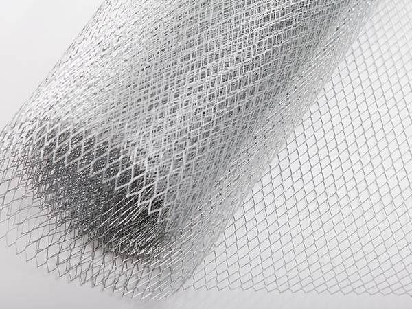 A roll of light type expanded metal on the grey background