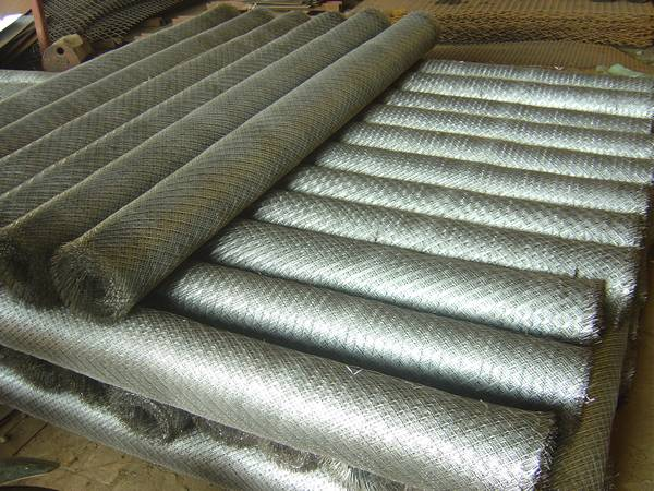 Expanded plaster mesh rolls neatly arranged in warehouse