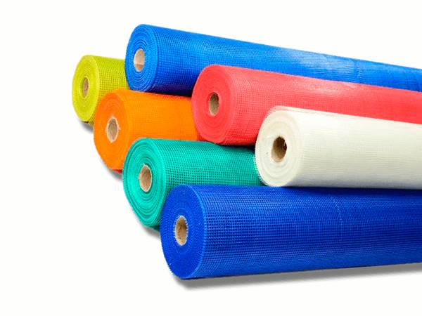 Seven rolls of fiberglass cloth in white, yellow, blue, green, red, and orange color.