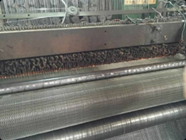 A welded machine is working with a row of welding sparks