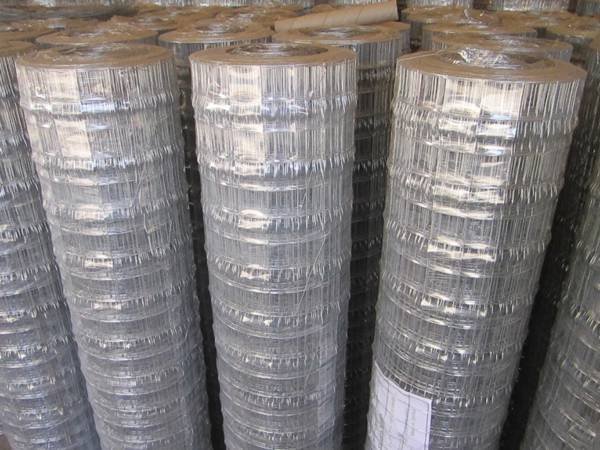 Many rolls of welded wire lath is enveloped with plastic film.